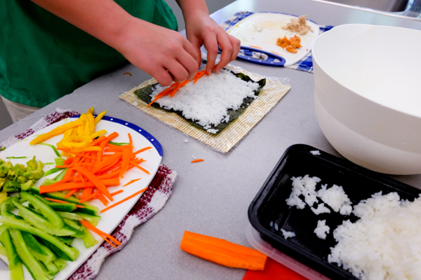 Kids rolling sushi with John Placko on eatlivetravelwrite.com