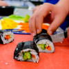 Kids cutting veggie sushi rolls with John Placko on eatlivetravelwrite.com