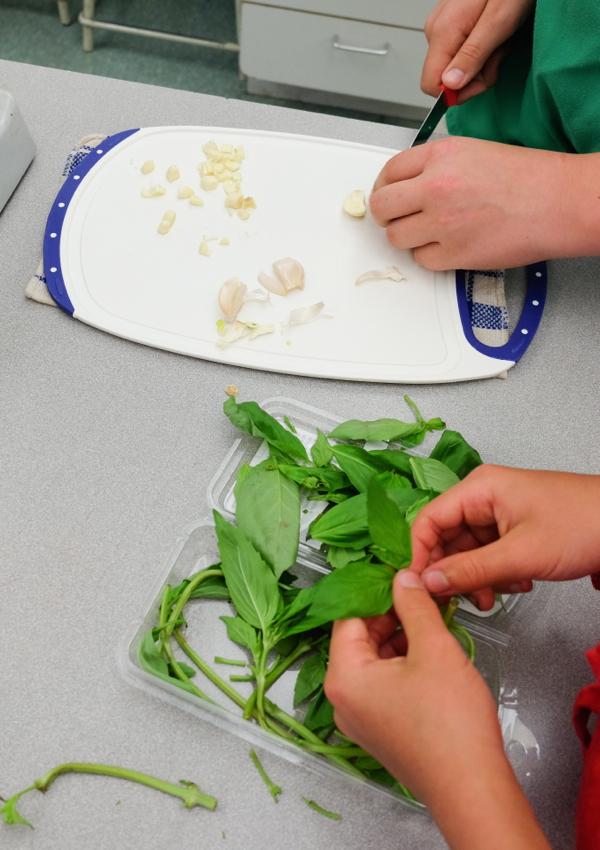 Picking basil leaves on eatlivetravelwrite.com