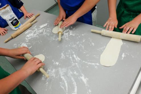 Kids rolling Jamie Oliver pizza dough on eatlivetravelwrite.com