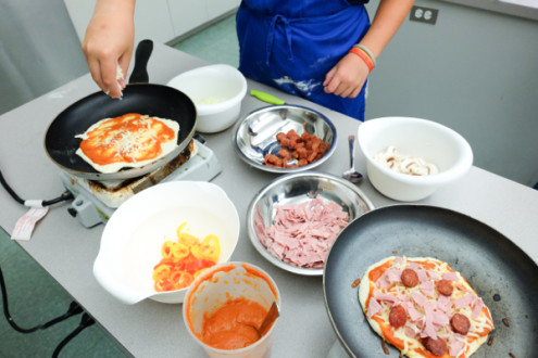Kids making Jamie Oliver cheat's pizza on eatlivetravelwrite.com