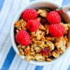 Bowl of granola with raspberries on eatlivetravelwrite.com