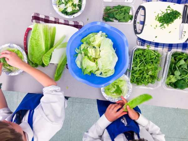 Kids making Jamie Oliver Food Revolution green salad on eatlivetravelwrite.com
