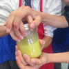 Kids making Jamie Oliver Food Revolution jam jar dressings on eatlivetravelwrite.com