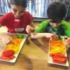 Kids arranging peppers for hummus on Food Revolution Day on eatlivetravelwrite.com