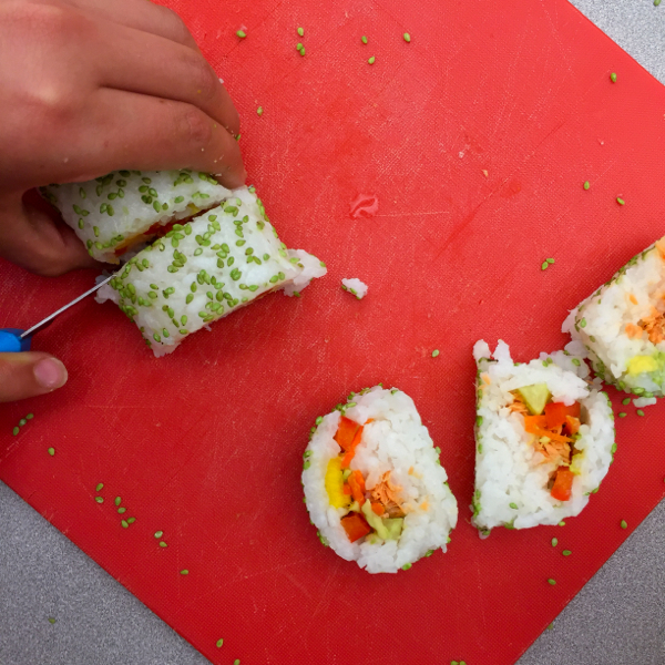Making sushi rolls rolled in wasabi sesame seeds with John Placko on eatlivetravelwrite.com