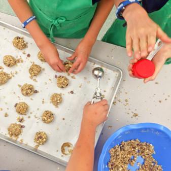 Kids shaping Mairlyn Smith Breakfast Grab n Go cookies on eatlivetravelwrite.com