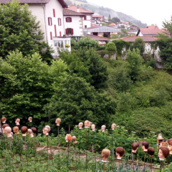 Heads on sticks to scare birds in Valcarlos on the Camino on eatlivetravelwrite.com