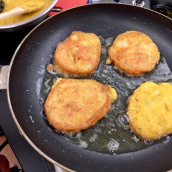 Persian potato fritters mid cook on eatlivetravelwrite.com