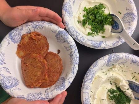 Kids assembling Persian potato fritters on eatlivetravelwrite.com