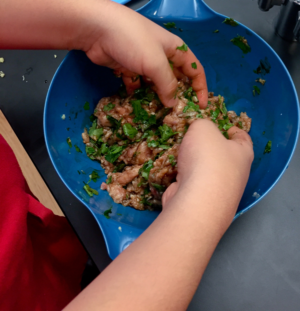 Mixing dumpling filling with our bare hands √