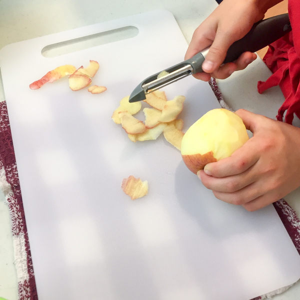 Kids peeling apples on eatlivetravelwrite.com