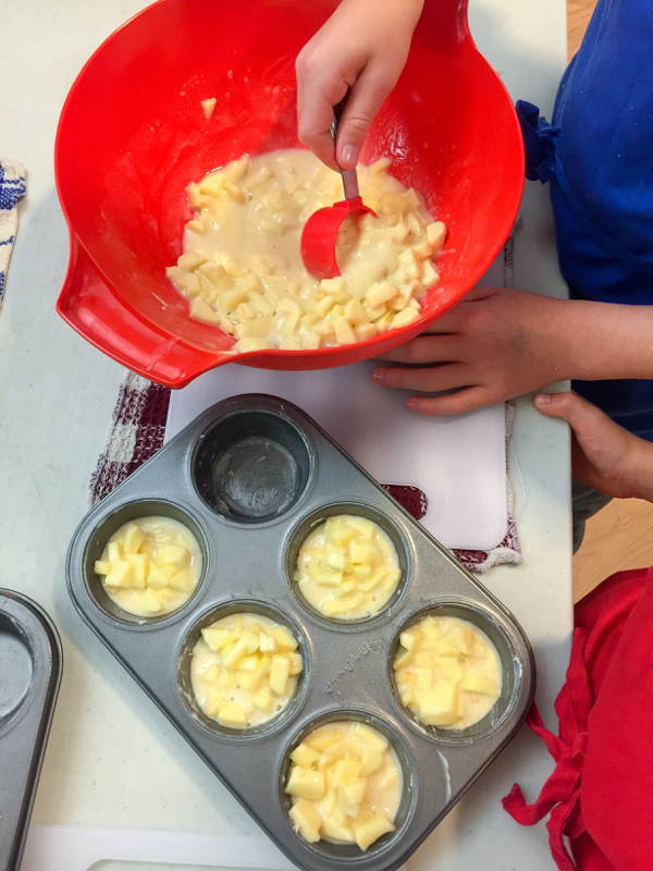 Tuesdays with Dorie Kids Making Dorie Greenspan custardy apple squares in muffin tins on eatlivetravelwrite.com