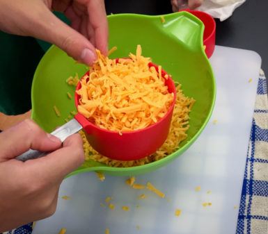 Grated cheese for gougeres on eatlivetravelwrite.com