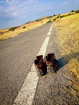 Boots on the road to Torres del Rio walking the Camino with Caminon Travel Center on eatlivetravelwrite.com