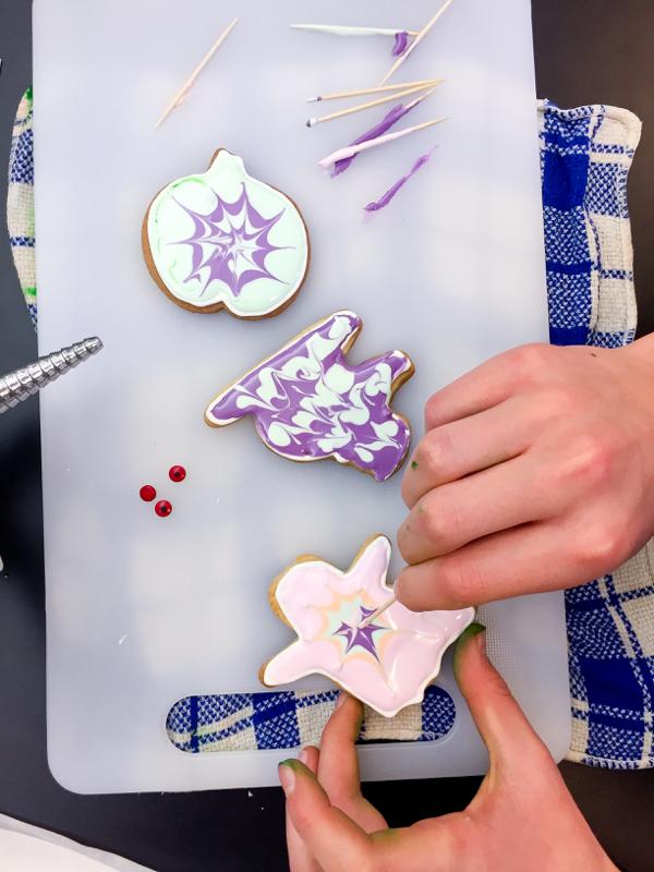Kids decorating Halloween cookies on eatlivetravelwrite.com