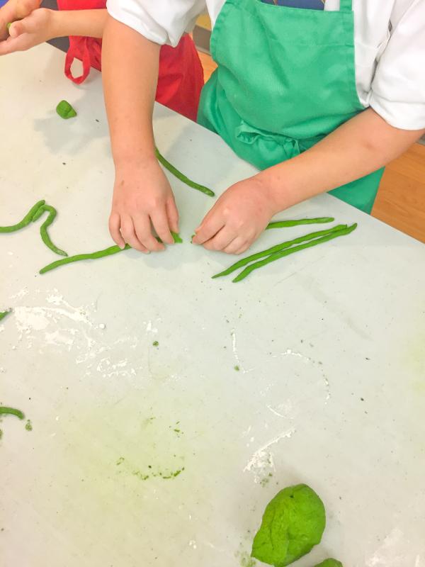 Rolling fresh pasta noodles on eatlivetravelwrite.com