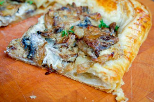 Slice of Creamy thyme and mushroom tart on eatlivetravelwrite.com