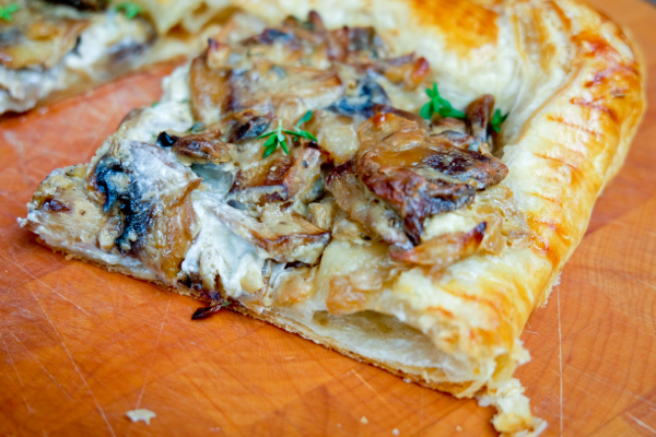 Slice of Creamy thyme and mushroom tart on eatlivetravelwrite.com