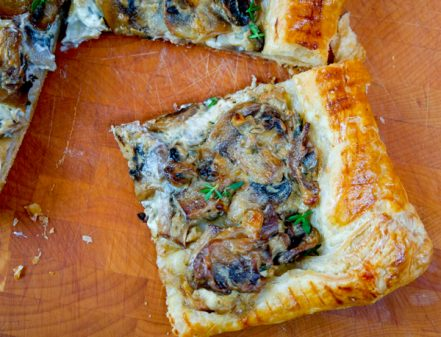 One slice of Creamy thyme and mushroom tart on eatlivetravelwrite.com