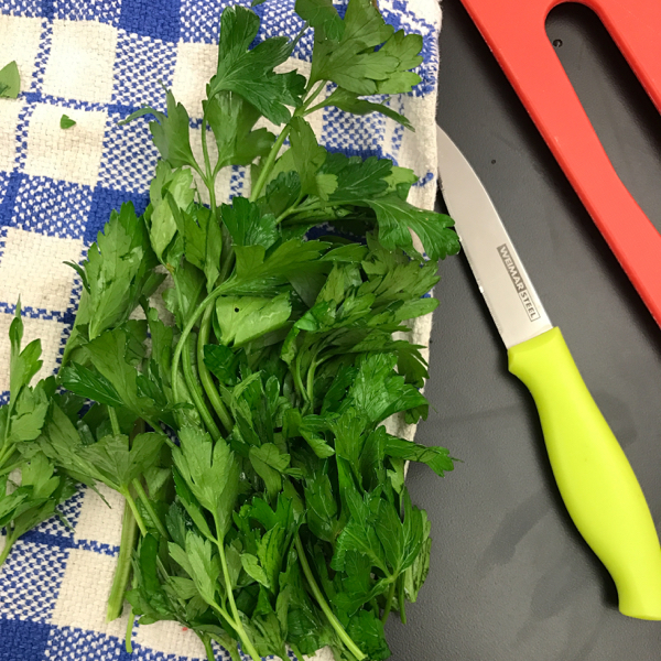 Kids chopping parsley with Emily Richards on eatlivetravelwrite.com