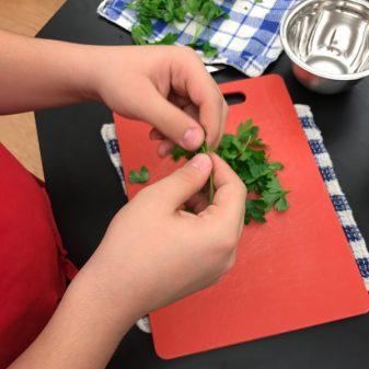Kids prepping parsley with Emily Richards on eatlivetravelwrite.com
