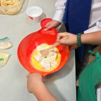 Kids making ricottta pasta filling with Emily Richards on eatlivetravelwrite.com