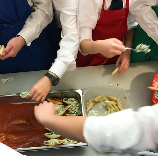 Kids filling pasta shells with Emily Richards on eatlivetravelwrite.com
