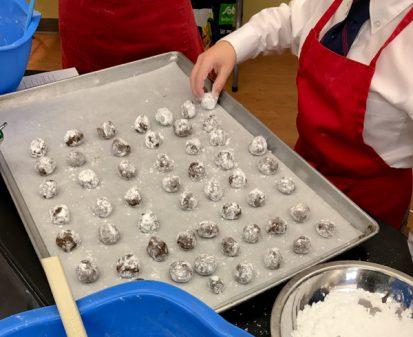Kids baking Canola Chocolate Mint Crinkle Cookies on eatlivetravelwrite.com