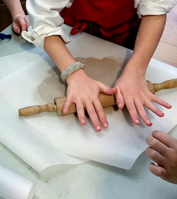 Kids rolling Jamie Oliver gingerbread on eatlivetravelwrite.com