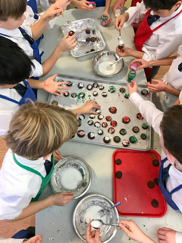 Kids decorating Abby Dodge chocolate thumbprint cookies on eatlivetravelwrite.com