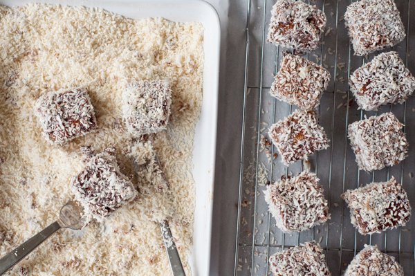 Dipping mini lamingtons in coconut on eatlivetravelwrite.com