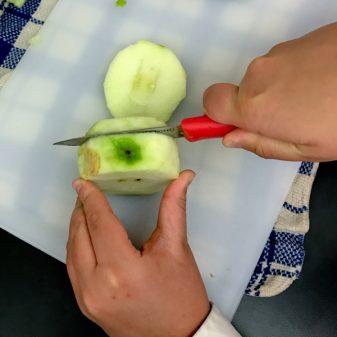 Slicing apples with kids on eatlivetravelwrite.com