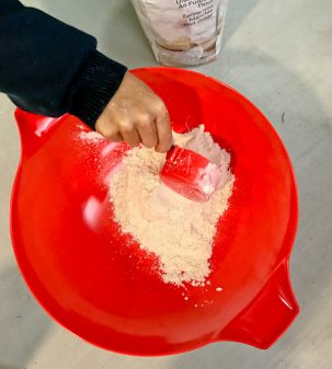Scooping flour with kids on eatlivetravelwrite.com