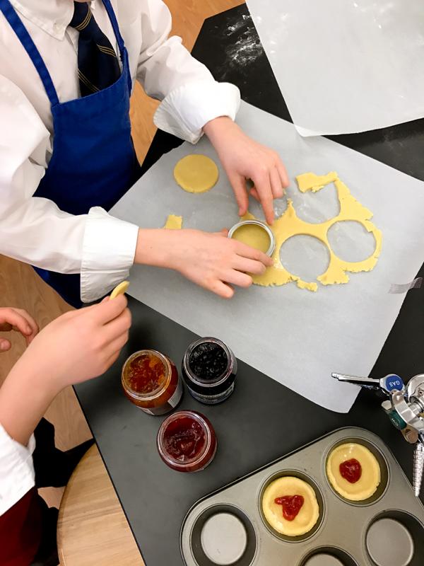 Kids cutting jam tart cases on eatlivetravelwrite.com
