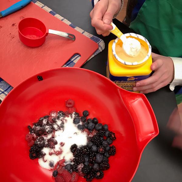 Kids making fruit pie filling on eatlivetravelwrite.com