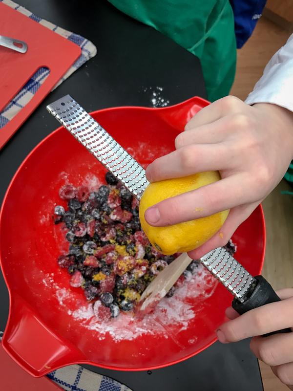 Kids zesting lemons for galette filling on eatlivetravelwrite.com