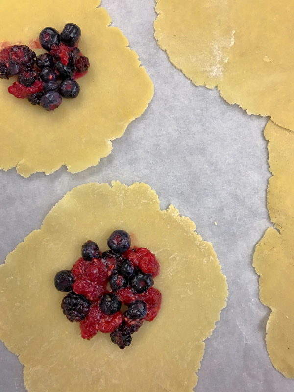 Berry galettes ready for folding the dough on eatlivetravelwrite.com
