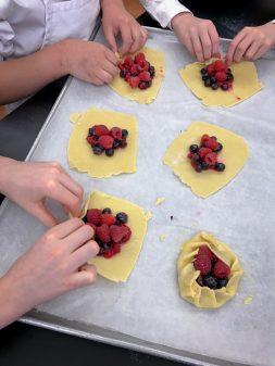 Kids pleating galette dough on eatlivetravelwrite.com