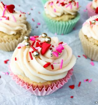 Strawberry yoghhurt cupcakes with strawberry cream cheese frosting for National Cupcake Day 2017 image on eatlivetravelwrite.com