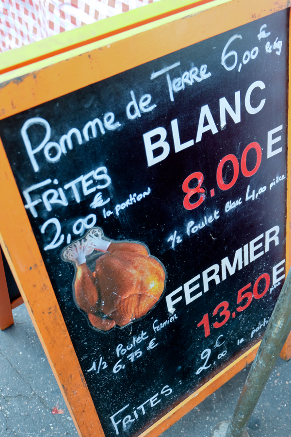 Roast chicken sign at the market in Lyon image on eatlivetravelwrite.com