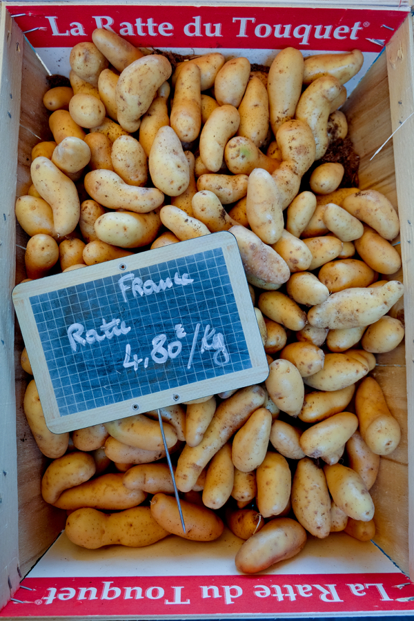 Ratte potatoes at the market in Lyon image on eatlivetravelwrite.com