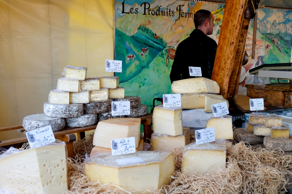 Cheese stand at the market in Lyon image on eatlivetravelwrite.com