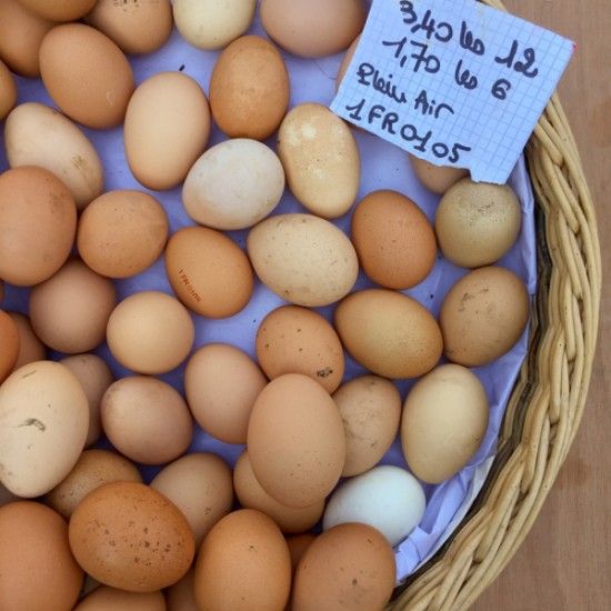 Eggs in a basket at the market in Lyon image on eatlivetravelwrite.com