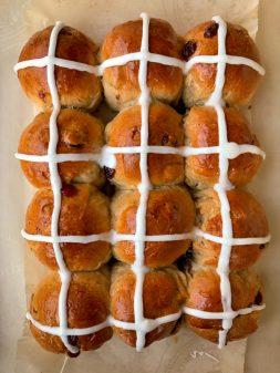 Cranberry orange hot cross buns image on eatlivetravelwrite.com