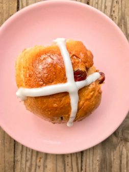 Orange cranberry hot cross bun image on eatlivetravelwrite.com