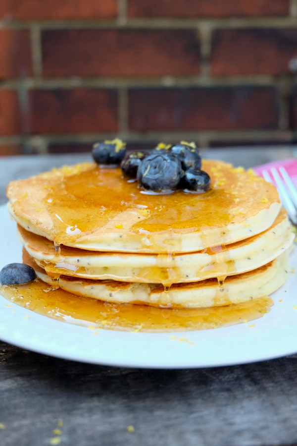 Stack of Lemon cottage cheese pancakes with blueberries on eatlivetravelwrite.cm