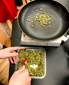 Toasting pumpkin seeds Skinny Carbonara from Everyday Super Food on eatlivetravelwrite.com
