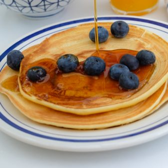 Ricotta pancakes with blueberries and maple syrup on eatlivetravelwrite.com
