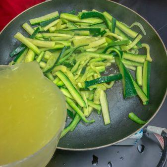 Adding lemon juice for Jamie Oliver Lemony Courgette Linguine on eatlivetravelwrite.com